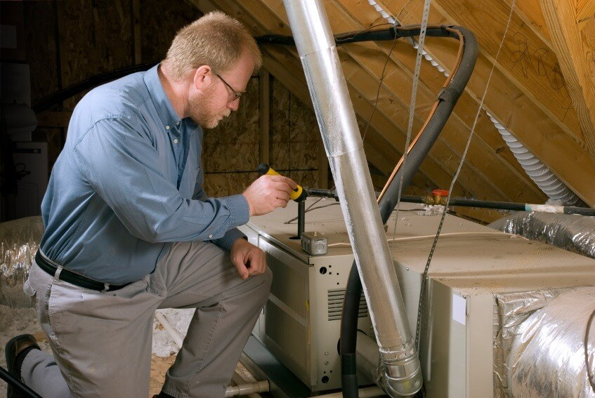 Furnace Repair Van Buren Township MI - Air Temperature Control - man_inspecting_furnace